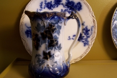 Antique flow blue pitcher and plate