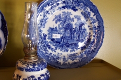 Antique transferware plate and Blue Willow oil lamp
