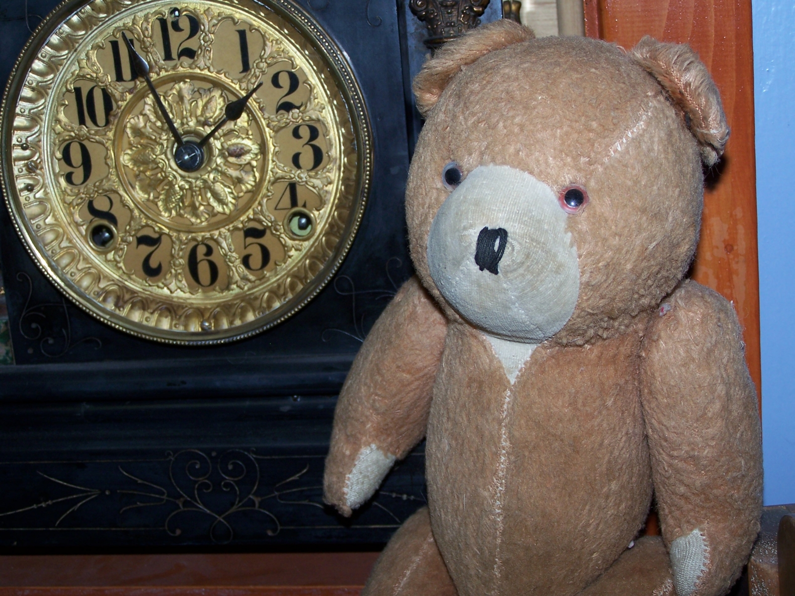 Antique Jointed teddy with clock