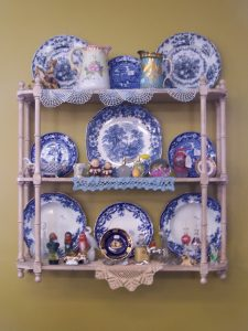 Antique flow blue and transferware on shelf